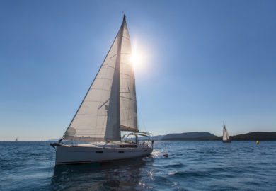 Sailing ship yachts regatta, shot boat against the sun.